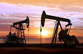 Oil pumps on sunset — Stock Photo