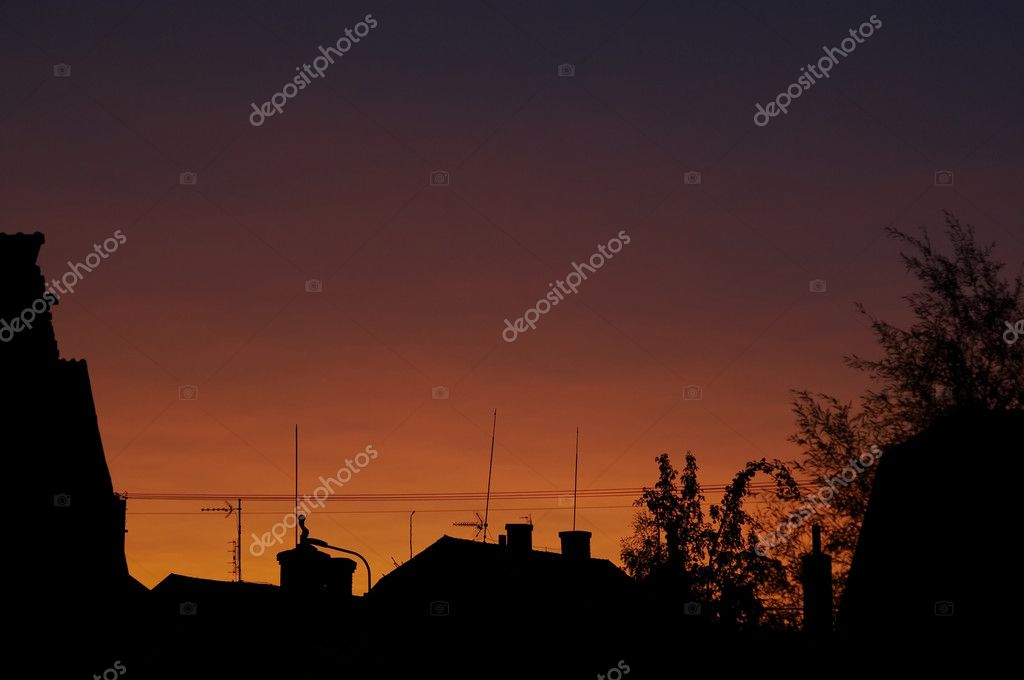 Abstract shot od the sunset, roofs with antennas  Stock Photo #4292015