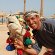 Stock Photo: Bedouin and his camel portrait
