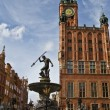 Foto Stock: Neptune and city hall in Gdansk