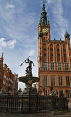 Neptune and city hall in Gdansk — Stock Photo