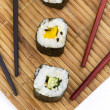 Stock Photo: Sushi with chopsticks