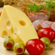 Cheese with olives and tomatoes — Stock Photo