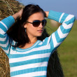 Girl on the meadow with sunglasses — Stock Photo #4241654