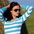 Girl on the meadow with sunglasses — Stock Photo
