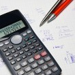 Mathematical calculator and hand counts in background — Stock Photo #5047470