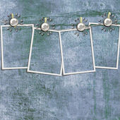 4 frames on a rope with clothespins against grange wall — Stock Photo