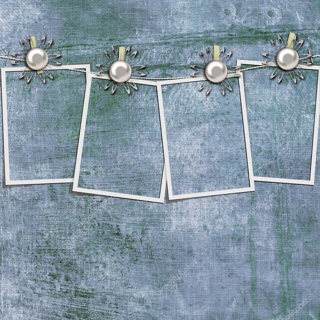 4 frames on a rope with clothespins against grange wall