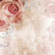 Beautiful wedding background with roses and pearls — Stock Photo