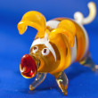 Stock Photo: Yellow toy pig against blue background