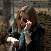 Girl taking off her sunglasses — Stock Photo