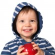 Laughing baby with red apple — Stock Photo #4283524