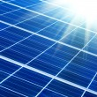 Solar panel with sunbeams - Stock Photo