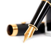 Fountain pen with ink bottle — Stock Photo