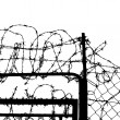 Wired fence with barbed wires — Stock Photo #5103610