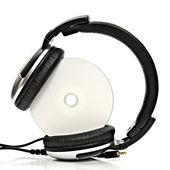 Headphones with compact disc — Stock Photo