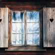 Stock Photo: Old window shutters in wooden wall