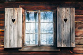 Old window shutters in wooden wall — Stock Photo