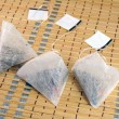 Tea bags in the shape of a pyramid — Stock Photo