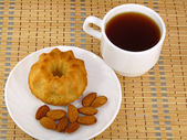 Tea and almond cake — Stock Photo