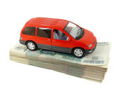 A toy car is a pack of Russian money, — Stock Photo