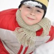 Portrait of a boy sitting in the snow — Stock Photo