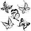 Set black white butterflies of a tattoo — Stock Vector #4601206