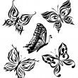 Set black white butterflies of a tattoo — Stock Vector #4817471
