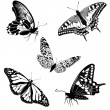 Set black white butterflies of a tattoo — Stock Vector #5235604