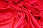 Smooth elegant red silk — Stock Photo