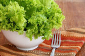 Salad with Butter Lettuce on wooden background — Stock Photo