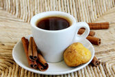 Cup of Coffee with cinnamon and biscuits — Stock Photo