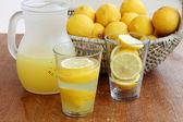 Ice Cold Lemonade on wooden background — Stock Photo