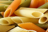 Penne rigate background — Stock Photo
