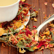 Healthy herbal  Tea with rose petals - Stock Photo