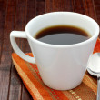 Cup of Coffee on wood background — Stock Photo