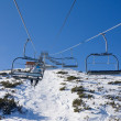 Chair ski lift over mountain landscape — Stock Photo