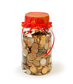 Coins in a jar bank as a gift — Stock Photo