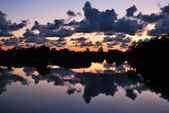 Cloudy sky in water reflection — Stock Photo
