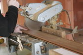 Carpenter cutting wood — Stock Photo