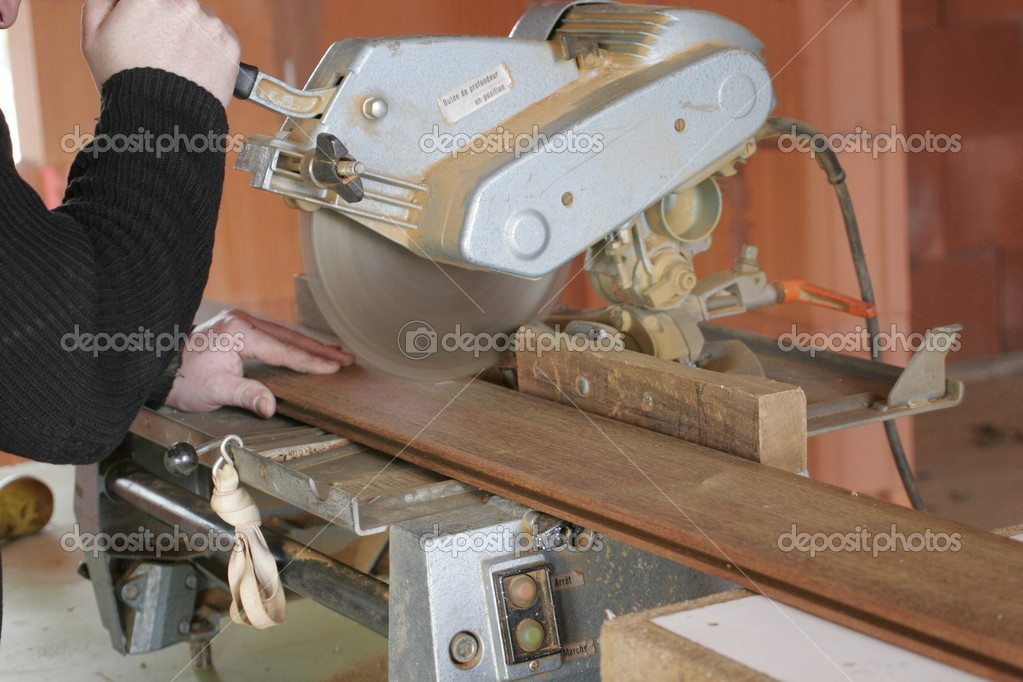 Carpenter working with a saw — Stock Photo #4720664