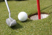 Putter, ball and hole — Stock Photo