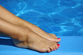 Sexy foot on swimming pool — Stock Photo