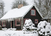 Winter cottage covered by snow — Stock Photo