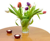 Romantic tulip bouquet on the table — Stock Photo