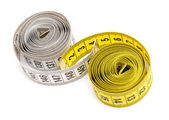 Yellow and white measuring tapes — Stock Photo