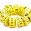 Yellow measuring tape - Stock Photo