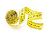 Yellow measuring tape i — Stock Photo