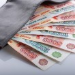 Russian rouble bills in black leather wallet — Stock Photo