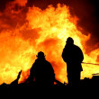 Firemen in Silhouette — Stock Photo #4661277